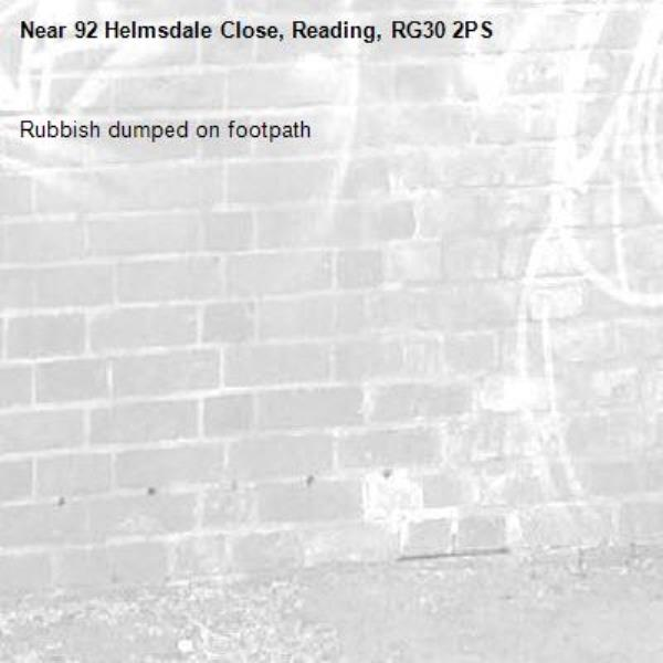 Rubbish dumped on footpath -92 Helmsdale Close, Reading, RG30 2PS