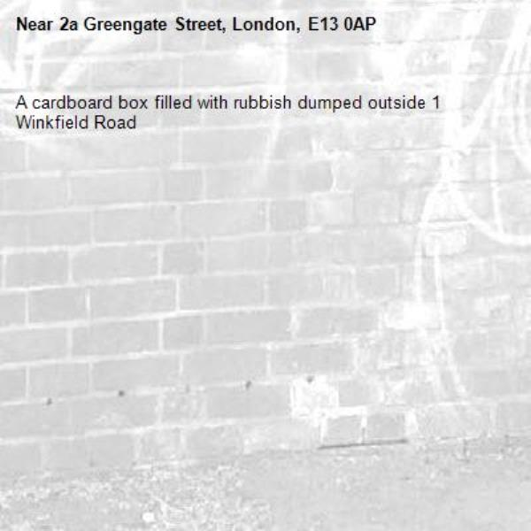 A cardboard box filled with rubbish dumped outside 1 Winkfield Road -2a Greengate Street, London, E13 0AP