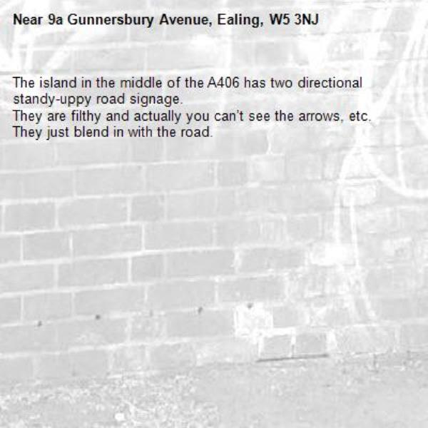 The island in the middle of the A406 has two directional standy-uppy road signage.  They are filthy and actually you can't see the arrows, etc. They just blend in with the road. -9a Gunnersbury Avenue, Ealing, W5 3NJ