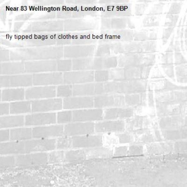 fly tipped bags of clothes and bed frame -83 Wellington Road, London, E7 9BP