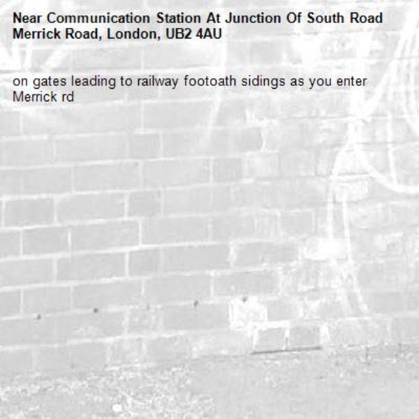 on gates leading to railway footoath sidings as you enter Merrick rd-Communication Station At Junction Of South Road Merrick Road, London, UB2 4AU