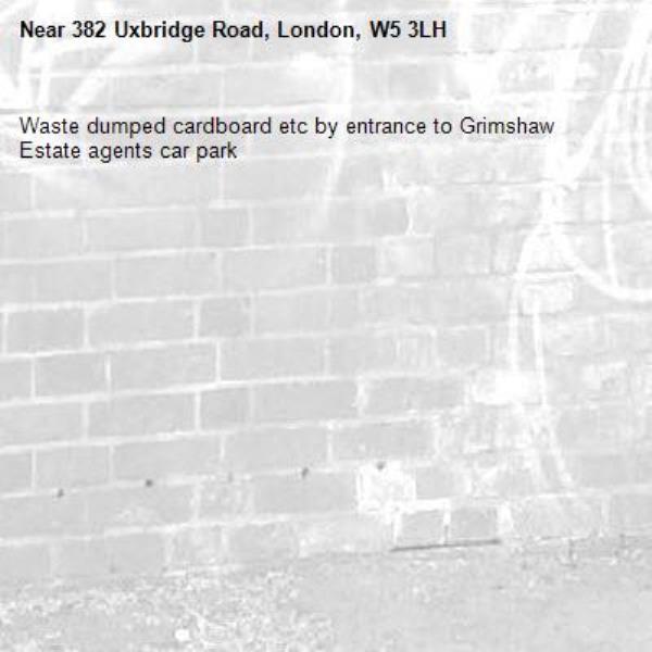 Waste dumped cardboard etc by entrance to Grimshaw Estate agents car park-382 Uxbridge Road, London, W5 3LH