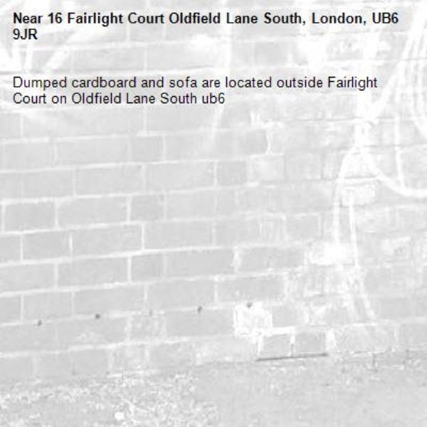 Dumped cardboard and sofa are located outside Fairlight Court on Oldfield Lane South ub6 -16 Fairlight Court Oldfield Lane South, London, UB6 9JR