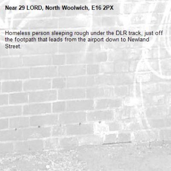 Homeless person sleeping rough under the DLR track, just off the footpath that leads from the airport down to Newland Street.-29 LORD, North Woolwich, E16 2PX