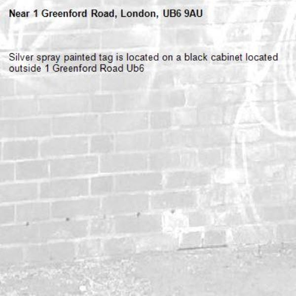 Silver spray painted tag is located on a black cabinet located outside 1 Greenford Road Ub6 -1 Greenford Road, London, UB6 9AU