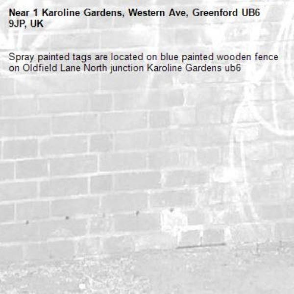 Spray painted tags are located on blue painted wooden fence on Oldfield Lane North junction Karoline Gardens ub6 -1 Karoline Gardens, Western Ave, Greenford UB6 9JP, UK