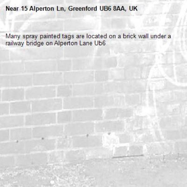 Many spray painted tags are located on a brick wall under a railway bridge on Alperton Lane Ub6 -15 Alperton Ln, Greenford UB6 8AA, UK