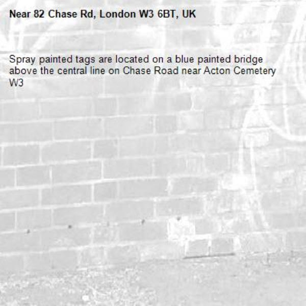 Spray painted tags are located on a blue painted bridge above the central line on Chase Road near Acton Cemetery W3-82 Chase Rd, London W3 6BT, UK