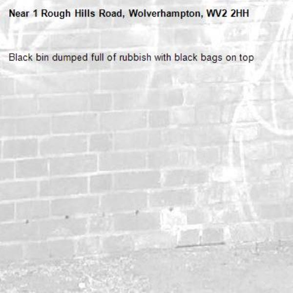 Black bin dumped full of rubbish with black bags on top-1 Rough Hills Road, Wolverhampton, WV2 2HH