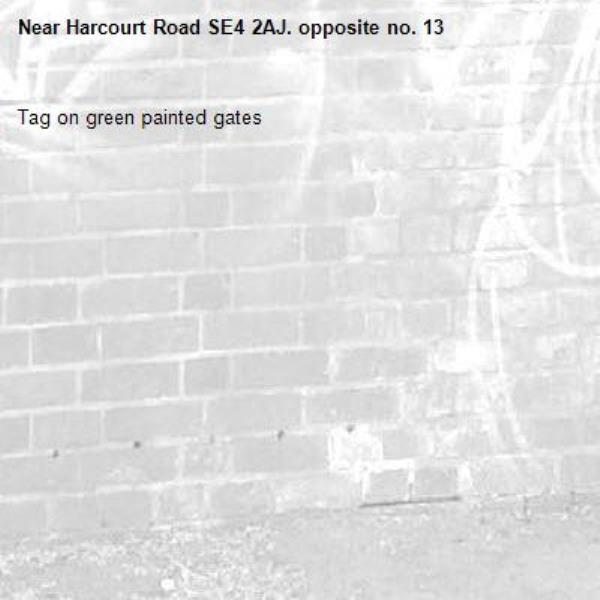 Tag on green painted gates-Harcourt Road SE4 2AJ. opposite no. 13