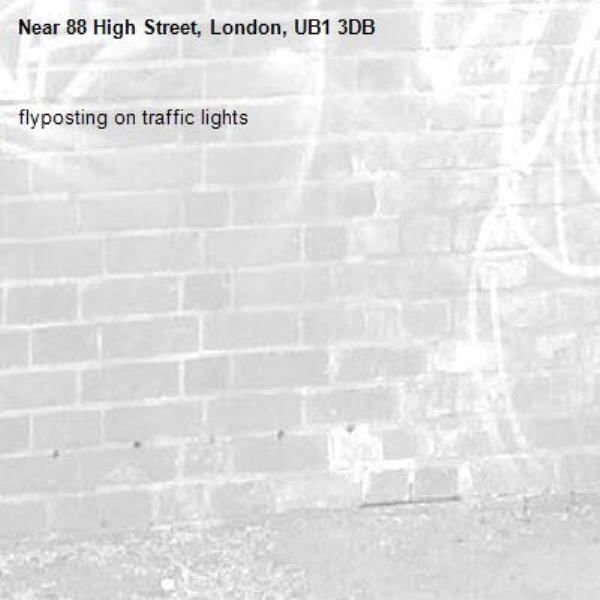 flyposting on traffic lights-88 High Street, London, UB1 3DB