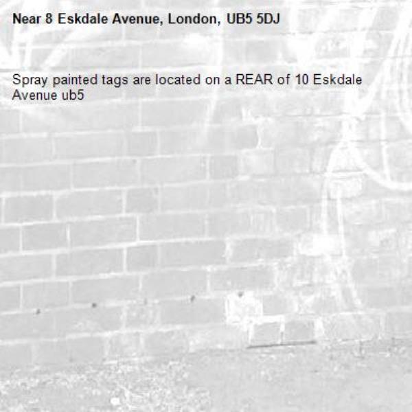 Spray painted tags are located on a REAR of 10 Eskdale Avenue ub5-8 Eskdale Avenue, London, UB5 5DJ