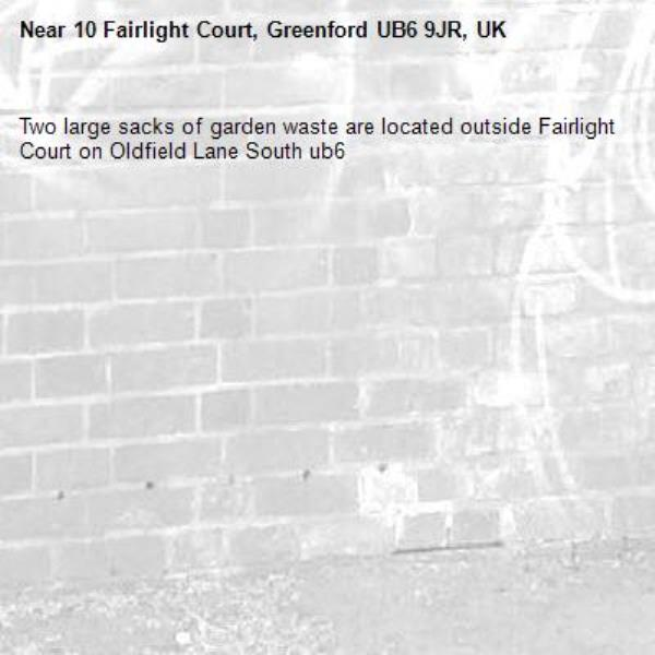 Two large sacks of garden waste are located outside Fairlight Court on Oldfield Lane South ub6 -10 Fairlight Court, Greenford UB6 9JR, UK