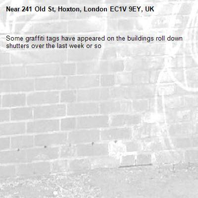 Some graffiti tags have appeared on the buildings roll down shutters over the last week or so-241 Old St, Hoxton, London EC1V 9EY, UK